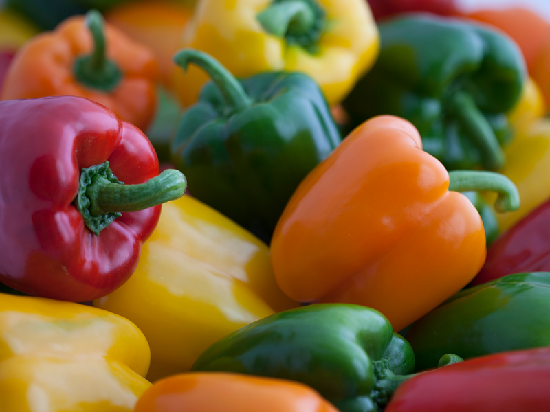 Green, yellow, red and orange sweet bell peppers